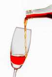 Pour the wine into a glass. On white background Stock Images