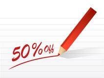 pourcentage 50 outre d'écrire sur un morceau de papier. Photo libre de droits