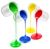 Poured from cans colorful liquid paints isolated Stock Photography