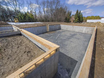 New House Foundation Construction. Poured concrete basement and house foundation Stock Photo