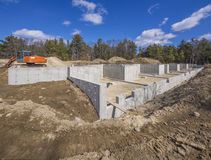 New House Foundation Construction. Poured concrete basement and house foundation Stock Images
