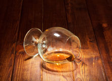 Poured Glass with cognac Royalty Free Stock Image
