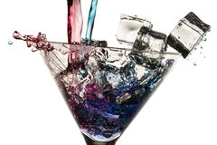 Poured red and blue liqueur in a glass Stock Photography