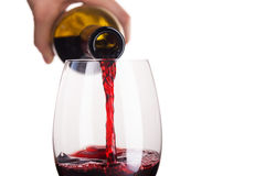 Poured red wine into glass royalty free stock images