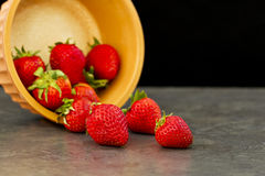 Poured strawberries Stock Photos
