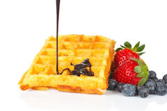 Poured syrup on waffles Stock Photo