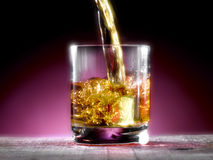 Poured whiskey. Whiskey poured into the glass Royalty Free Stock Photography