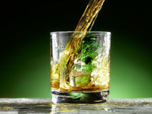 Poured whiskey. Whiskey poured into the glass Stock Photography