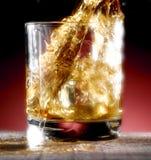 Poured whiskey. Whiskey poured into the glass Stock Photo