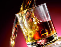 Poured whiskey. Whiskey poured into the glass Royalty Free Stock Images