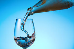 Pouring. Image of water being poured from a bottle into a glass Royalty Free Stock Image