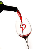 Pouring A Heart Of Red Wine Into A Glass Stock Photo
