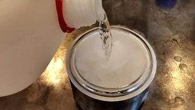Pouring acetone on dry ice and carbon dioxide smoke generation in a dewar flask. With a close view stock footage
