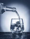 Pouring alcohol into a glass. Royalty Free Stock Image