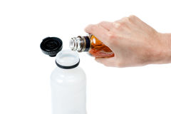 Pouring alcohol in water bottle Royalty Free Stock Images