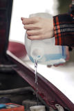 Pouring Antifreeze Washer Fluid into Windshield Washer Tank Stock Images