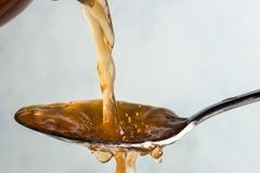 Free Pouring Apple Cider Vinegar Onto A Spoon Stock Image - 101897771