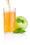 Pouring apple juice into a glass Stock Photography