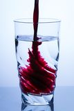 Pouring aronia juice Royalty Free Stock Images
