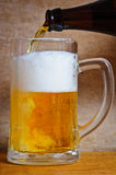 Pouring beer Stock Images
