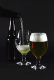 Pouring beer in glass. Stock Photo