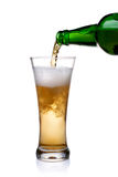Pouring beer into glass. Beer being pour on a glass over a white background Stock Photography