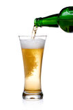 Pouring beer into glass Royalty Free Stock Images