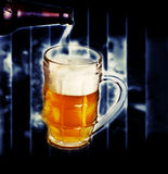 Pouring beer into mug Stock Image