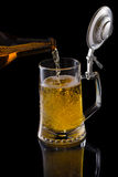 Pouring beer. Into a mug Stock Images