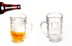 Pouring beer into mug and empty glass for beer Stock Photo