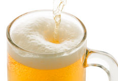 Pouring beer to glass isolated on white Stock Images