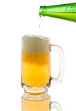 Pouring beer to glass isolated on white Royalty Free Stock Images