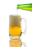 Pouring beer to glass isolated on white Royalty Free Stock Photos