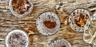 Pouring beer. View from above. Closeup Royalty Free Stock Photos