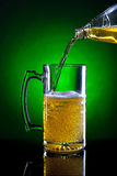 Pouring beer from a bottle. Royalty Free Stock Photo