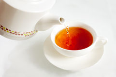 Pouring boiling water into a tea cup Stock Photos
