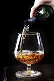 Pouring brandy Royalty Free Stock Photography
