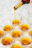 Pouring the brandy or cognac Stock Photography