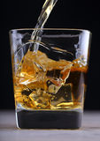 Pouring brandy into glass Royalty Free Stock Photography