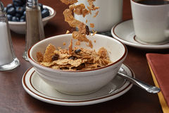 Pouring breakfast cereal Royalty Free Stock Image