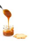 Pouring caramel in a small jar Stock Photos
