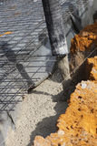 Pouring cement foundations Royalty Free Stock Photography