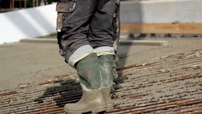 Pouring cement on the ground Stock Photography