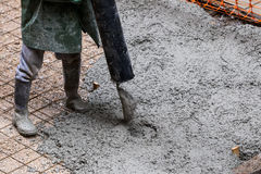 Pouring cement during sidewalk upgrade. Royalty Free Stock Images