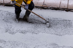 Pouring cement during sidewalk upgrade Royalty Free Stock Image