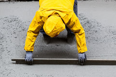 Pouring cement during sidewalk upgrade Royalty Free Stock Photo
