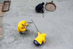 Pouring cement during sidewalk upgrade Royalty Free Stock Photography