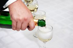 Pouring of champagne Stock Photos
