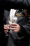 Pouring champagne Stock Photo