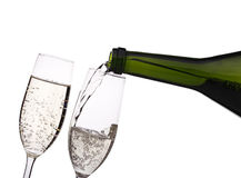Pouring champagne into the glass Royalty Free Stock Photos